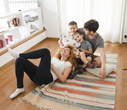 Happy family hanging out in living room