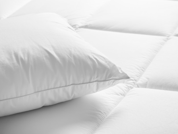 Closeup of white pillow on the bed