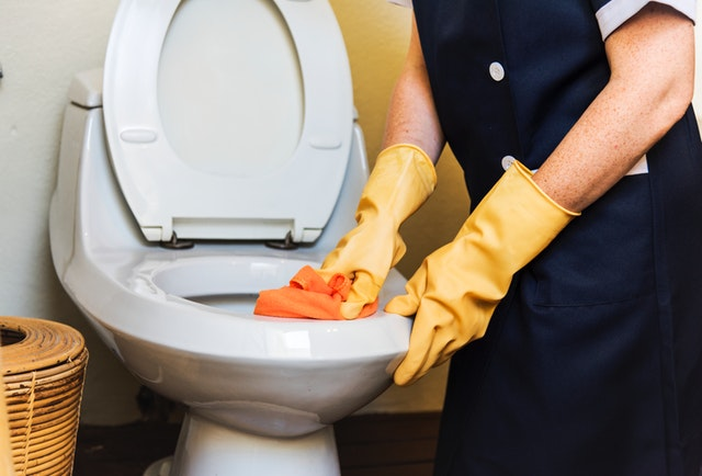Someone Cleaning Toilet Bowl